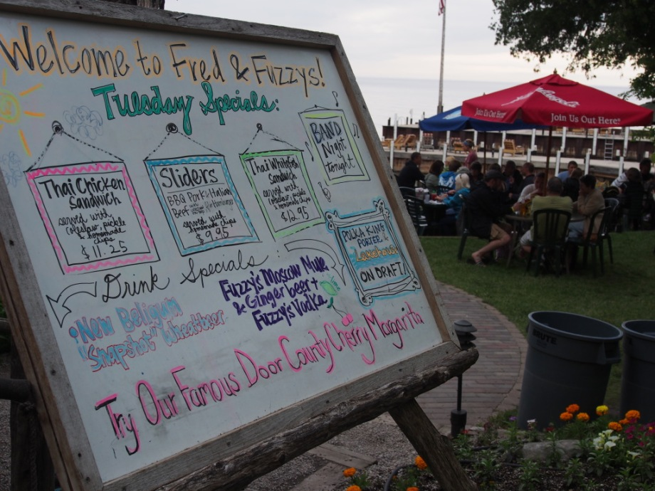 Fred & Fuzzy's Daily Specials board, featuring live music on Tuesdays